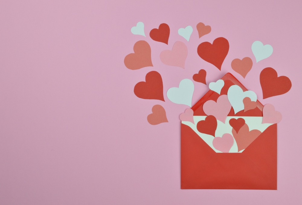 Open envelope with hearts coming out- valentines day graphic